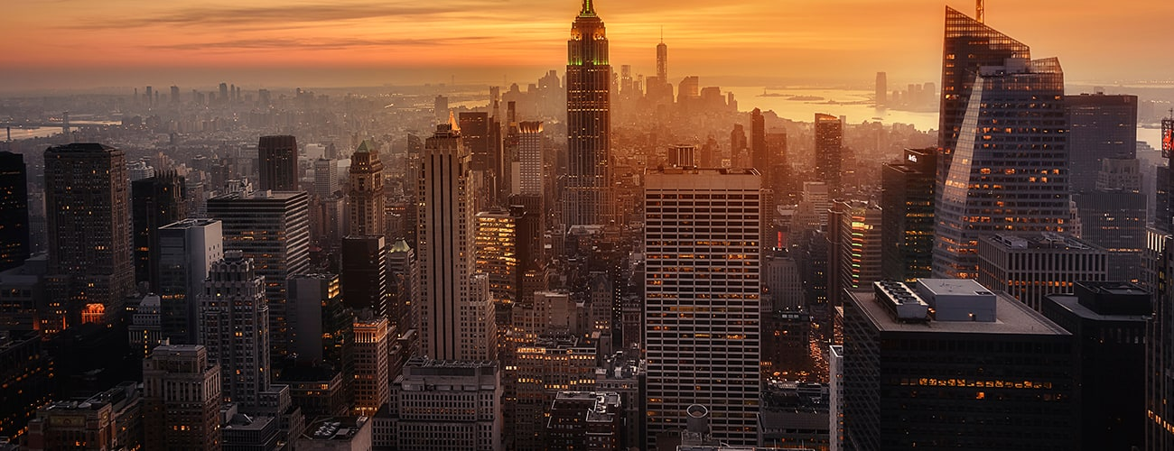View of New York City from the top of one of its viewpoints, capturing the warm light of sunset